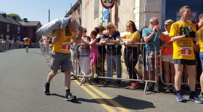 Cheers as David, 72, crosses World Coal Carrying Championships finish line