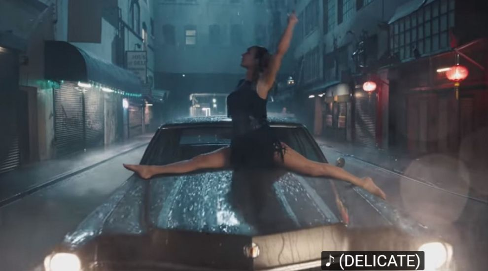 Taylor Swift turns invisible and dances in the rain in new