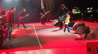 Boy, five, delights crowd by dancing on stage with Foo Fighters