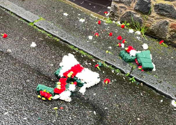 Three arrested over wreath destruction