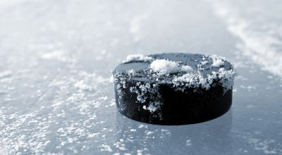 Watch: Hockey puck narrowly misses sports commentator's head